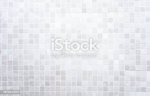White mosaic tiles on a wall