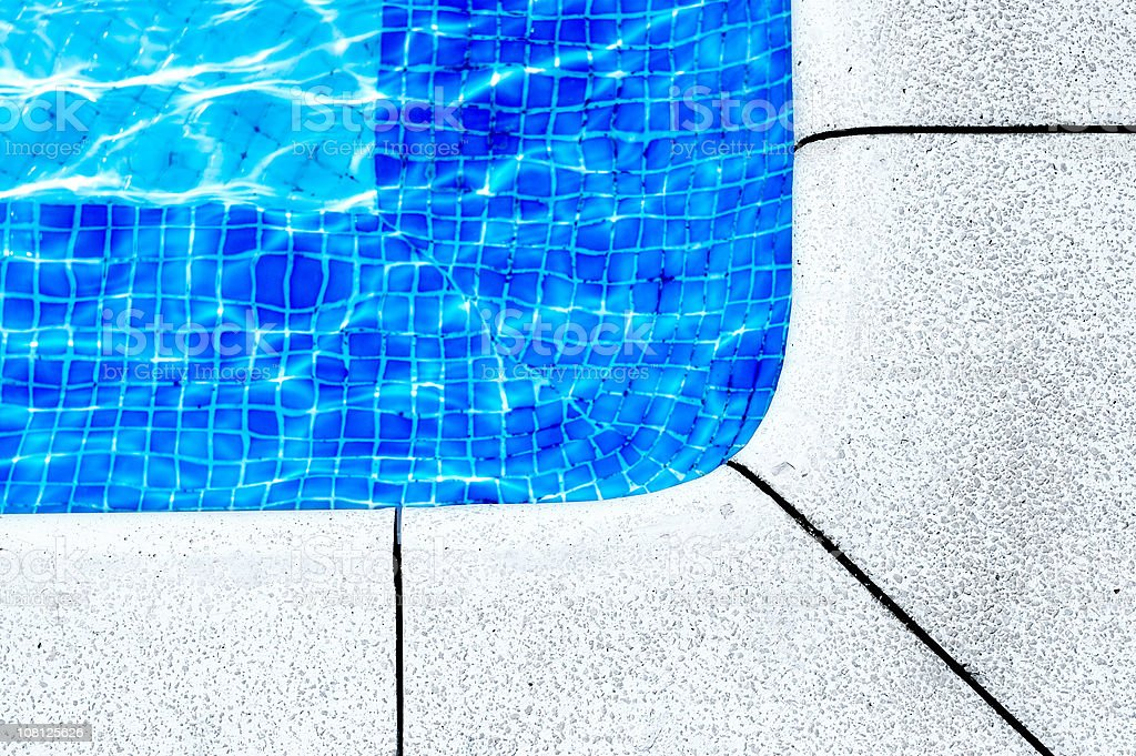 Tiles in Corner of Swimming Pool royalty-free stock photo