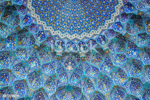 Ceiling and wall tilework at the Shah Mosque on Imam Square, Isfahan, Iran. The mosque is also known as Imam Mosque and Jaame' Abbasi Mosque. It is one of the masterpieces of Iranian/Persian Architecture and an excellent example of Islamic era architecture of Iran and also one of the top sights of the contry.