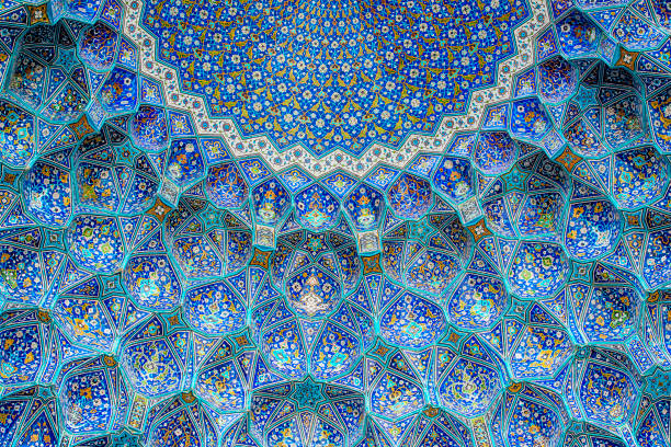 Tilework at Shah Mosque on Imam Square, Isfahan, Iran Ceiling and wall tilework at the Shah Mosque on Imam Square, Isfahan, Iran. The mosque is also known as Imam Mosque and Jaame' Abbasi Mosque. It is one of the masterpieces of Iranian/Persian Architecture and an excellent example of Islamic era architecture of Iran and also one of the top sights of the contry. arabic style stock pictures, royalty-free photos & images