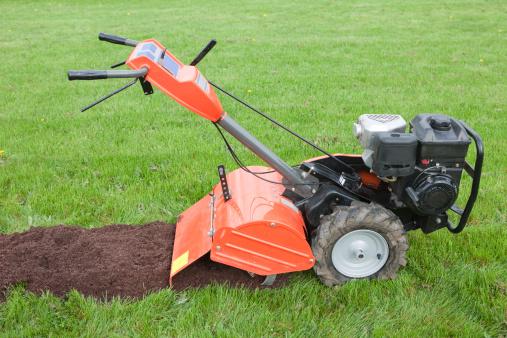 Rotovating/tilling garden. Preparing vegetable patches