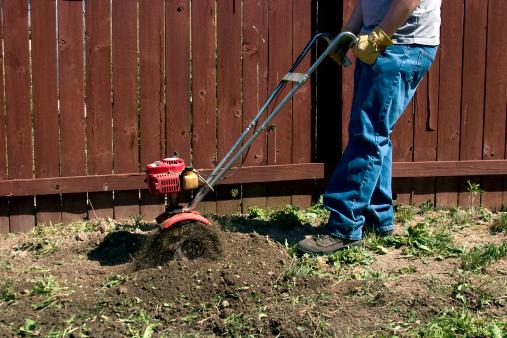 Tilling a new garden space.