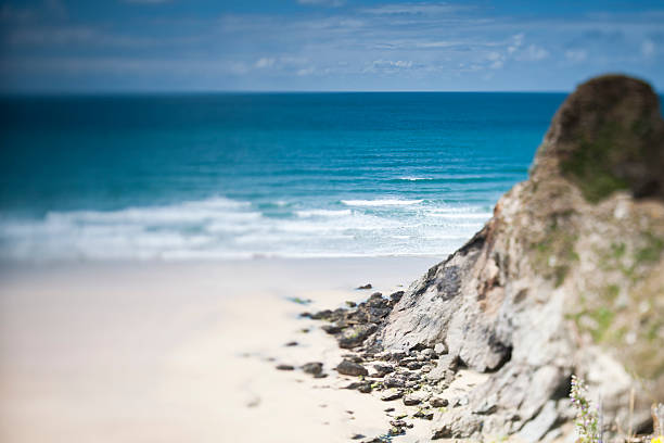 tilt and shift shallow focus, whipsiderry beach, newquay - cornwall stock photos and pictures