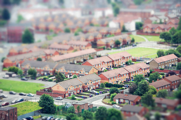 Tilt Shift Aerial View of Urban Housing High angle view of houses in a neighbourhood in Liverpool, England. northwest england stock pictures, royalty-free photos & images