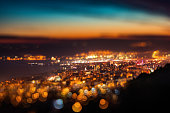Tilt shift blur effect. Night aerial view panorama of Varna Town, Bulgaria