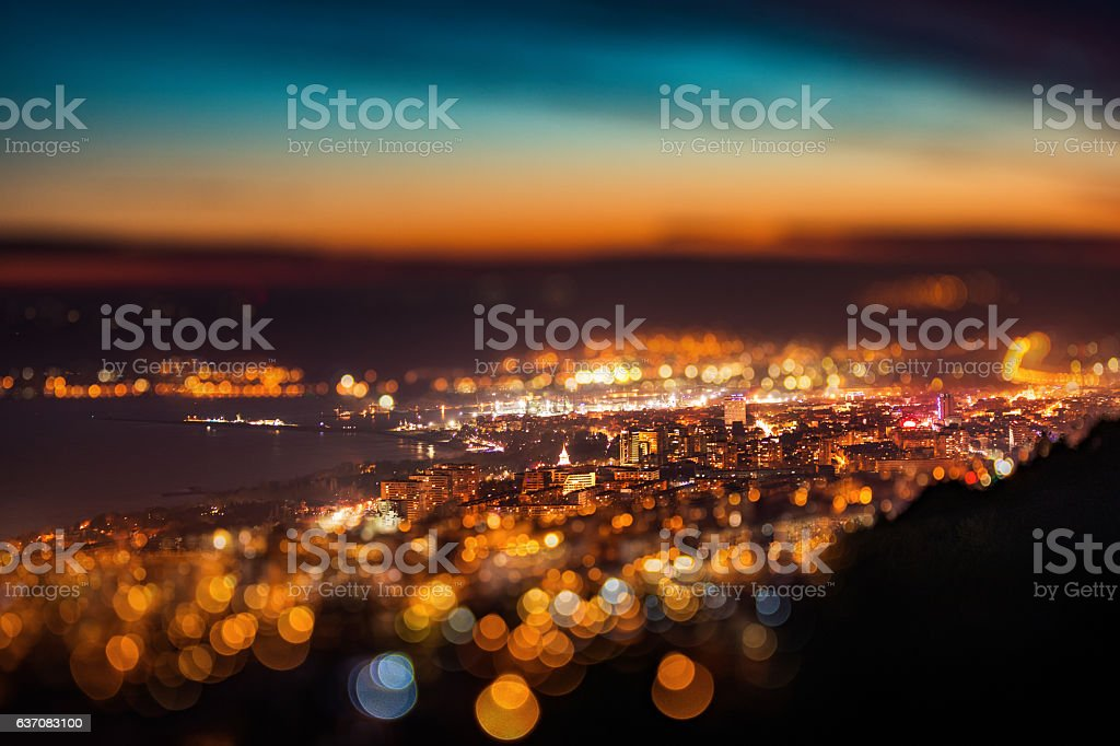 Tilt shift blur effect. Night aerial view panorama of Varna stock photo