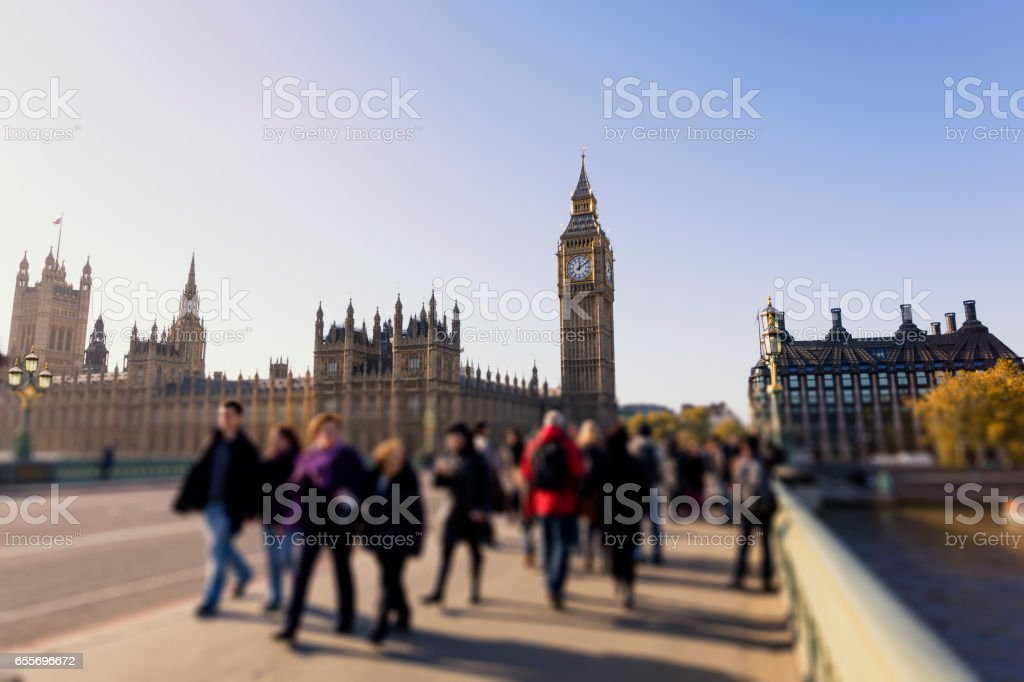 Tilt shift blur with crowd of people walking on Westminster Bridge stock photo