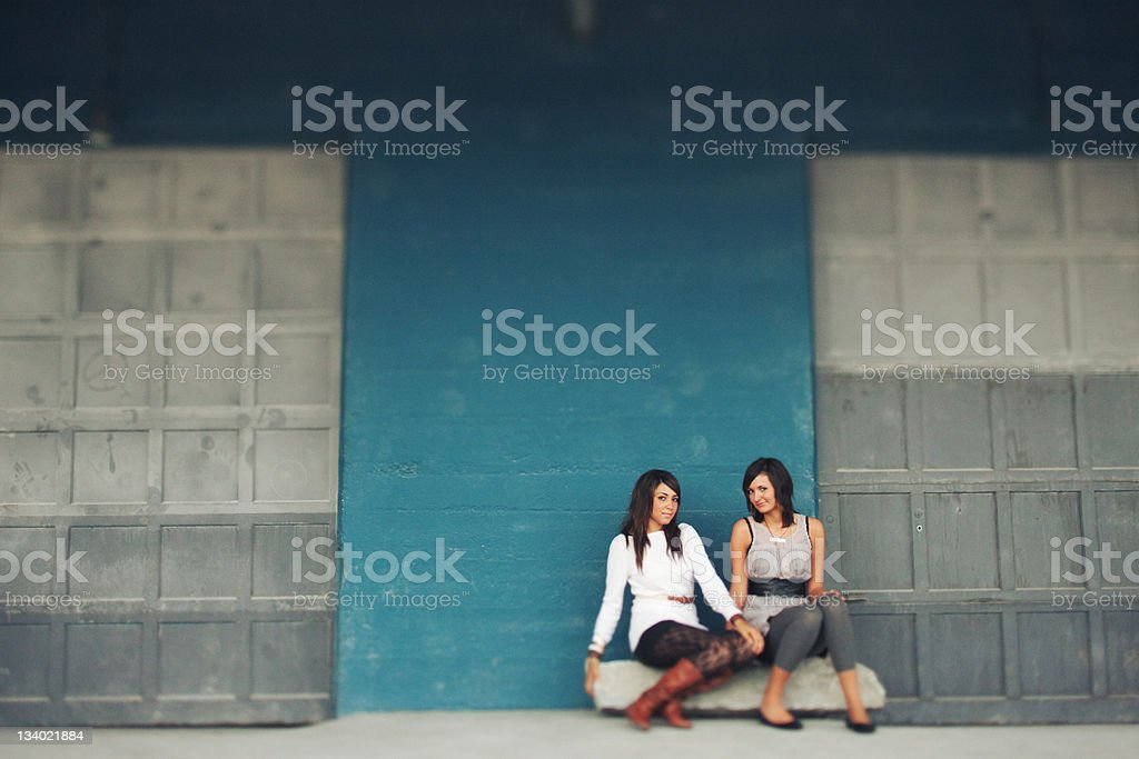 Tilt Shift Industrial Area Female Friends Sitting royalty-free stock photo