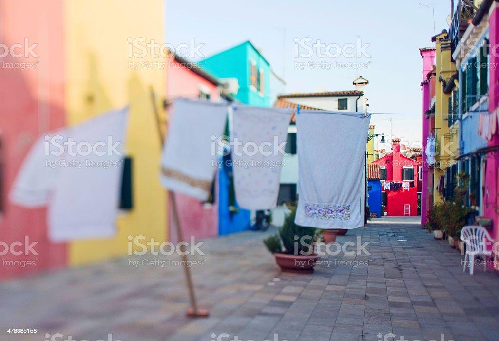 Tilt shift photo in street of Burano island stock photo