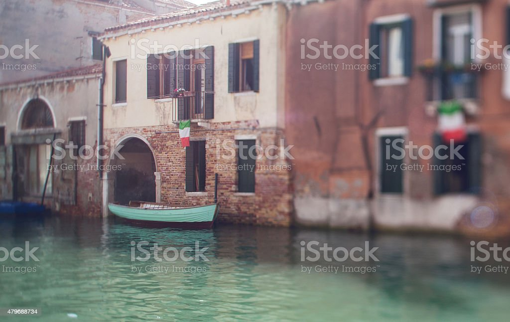 Tilt shift photo of Venice street with boat. Soft focus stock photo