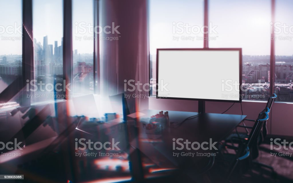 True tilt-shift shooting of abstract modern office meeting room with...