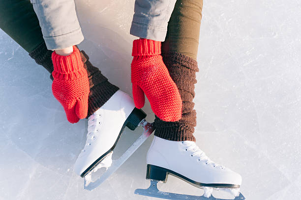 Tilted blue version, ice skates with reflection Tilted blue version, ice skates with reflection. ice skating stock pictures, royalty-free photos & images