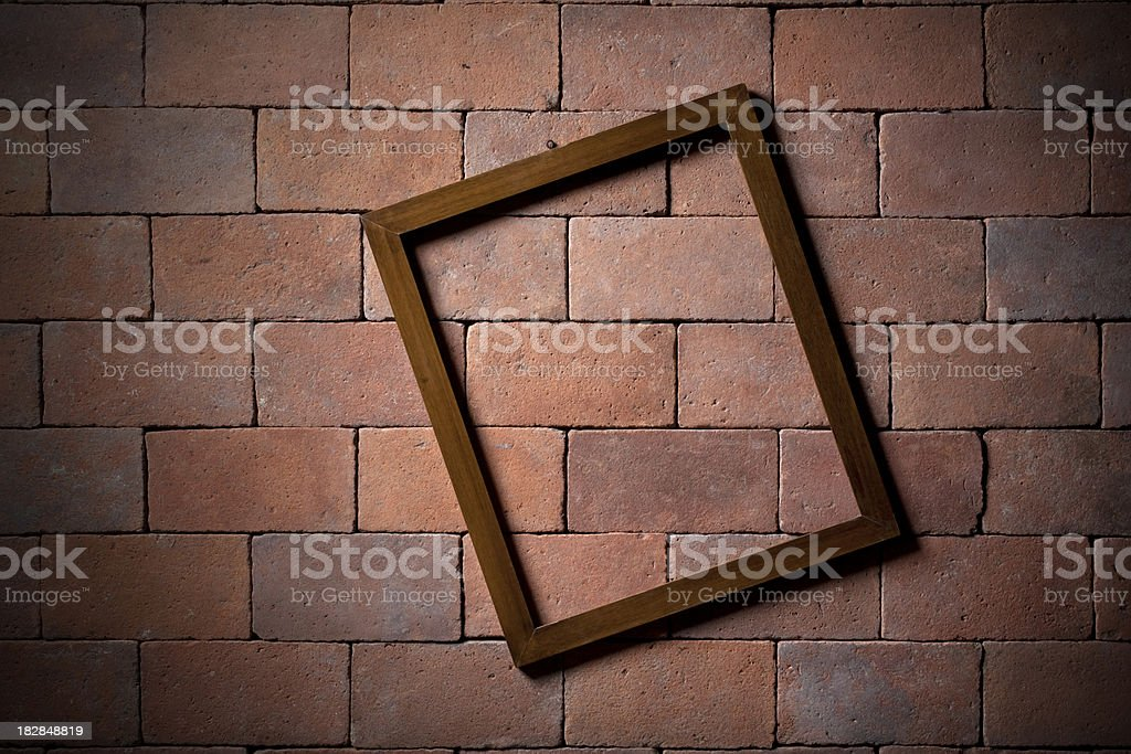 Tilted frame on a brick wall royalty-free stock photo