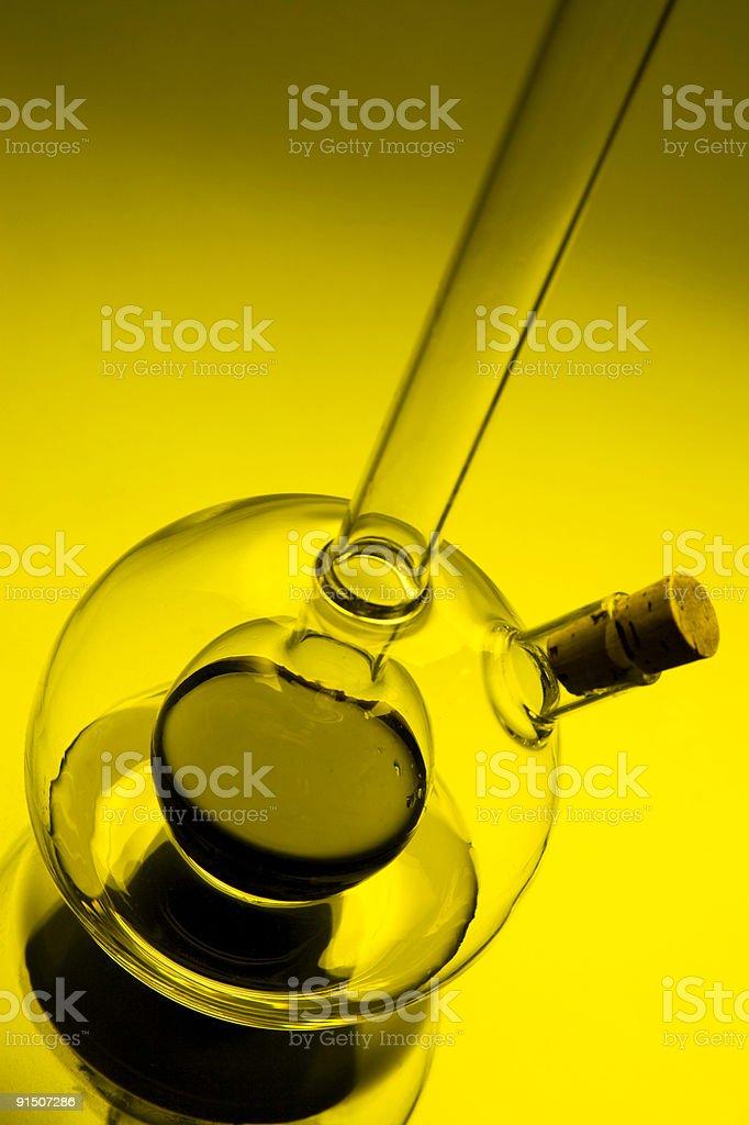 Tilted Glass Vinaigrette Bottle in yellow light royalty-free stock photo