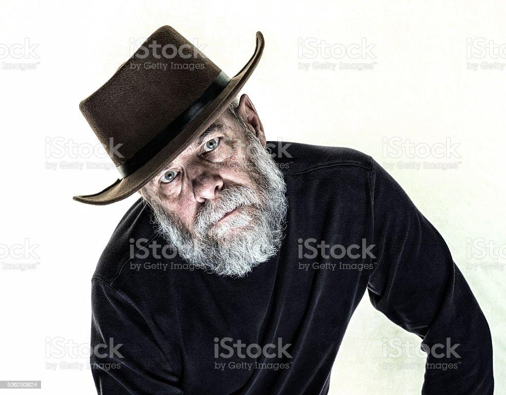 Tilted Head Serious Senior Man Wearing Felt Cowboy Hat Stock Photo ... a6706077923