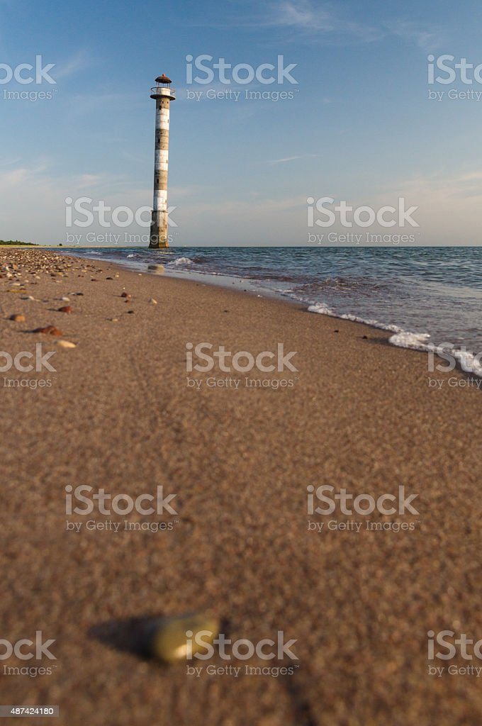 Tilted Kiipsaare lighthouse from beach surface view stock photo