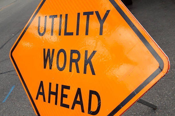Tilted Utility Work Ahead sign
