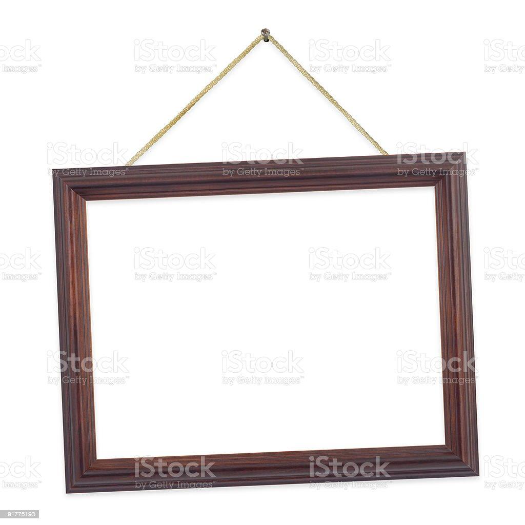 tilted wooden frame hanging on a string stock photo more pictures of art istock. Black Bedroom Furniture Sets. Home Design Ideas