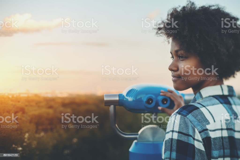 Tilt-shift portrait of black girl with binacular stock photo