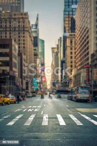Tilt-shift view of a crosswalk in a New-York city avenue, USA