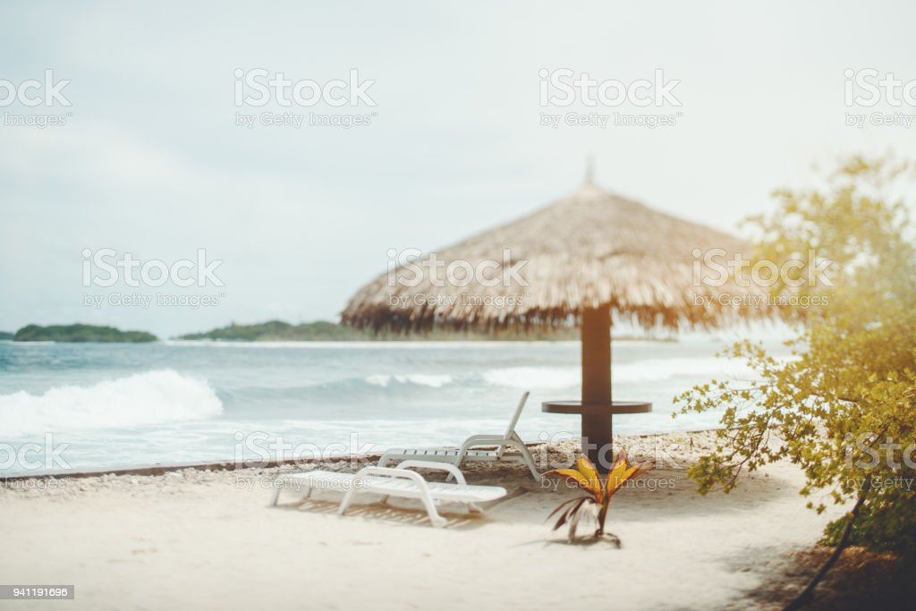 Tiltshift view of resort beach with recliners and the sunshade stock photo