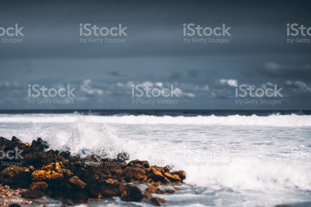 Tiltshift view of the stony seashore stock photo