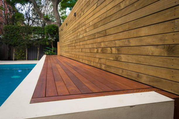 timber deck fencing along the pool stock photo