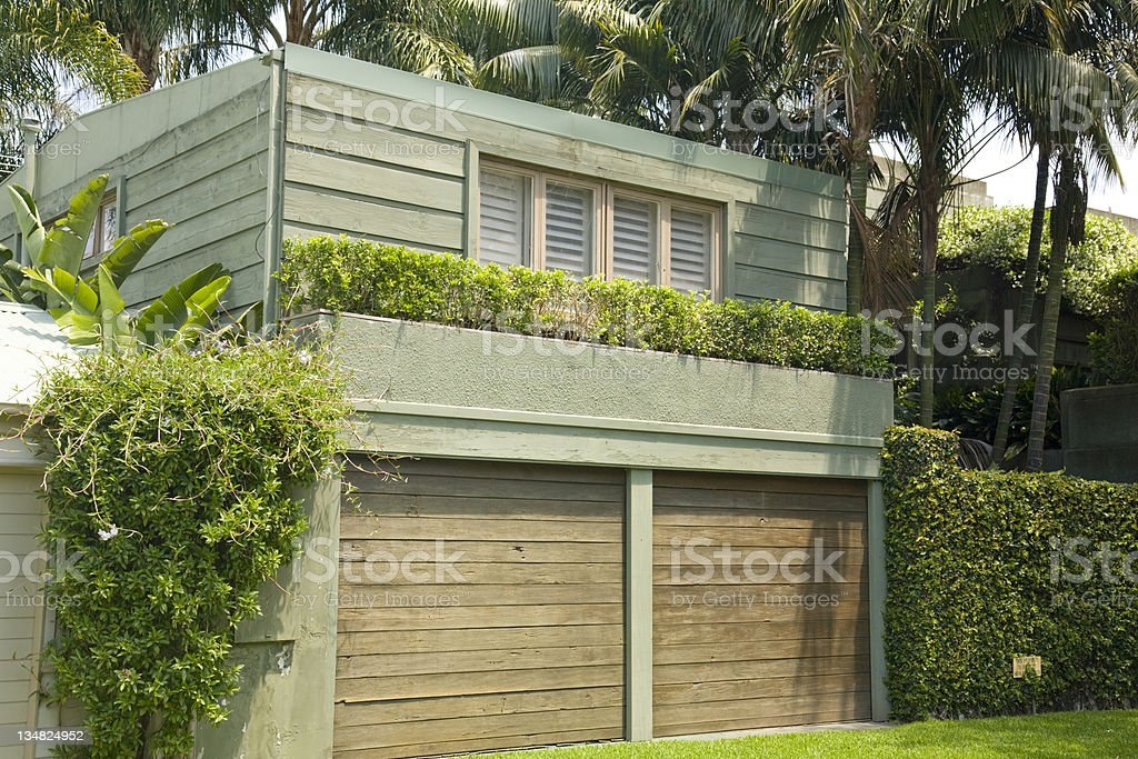timber double garage doors on luxury home royalty-free stock photo