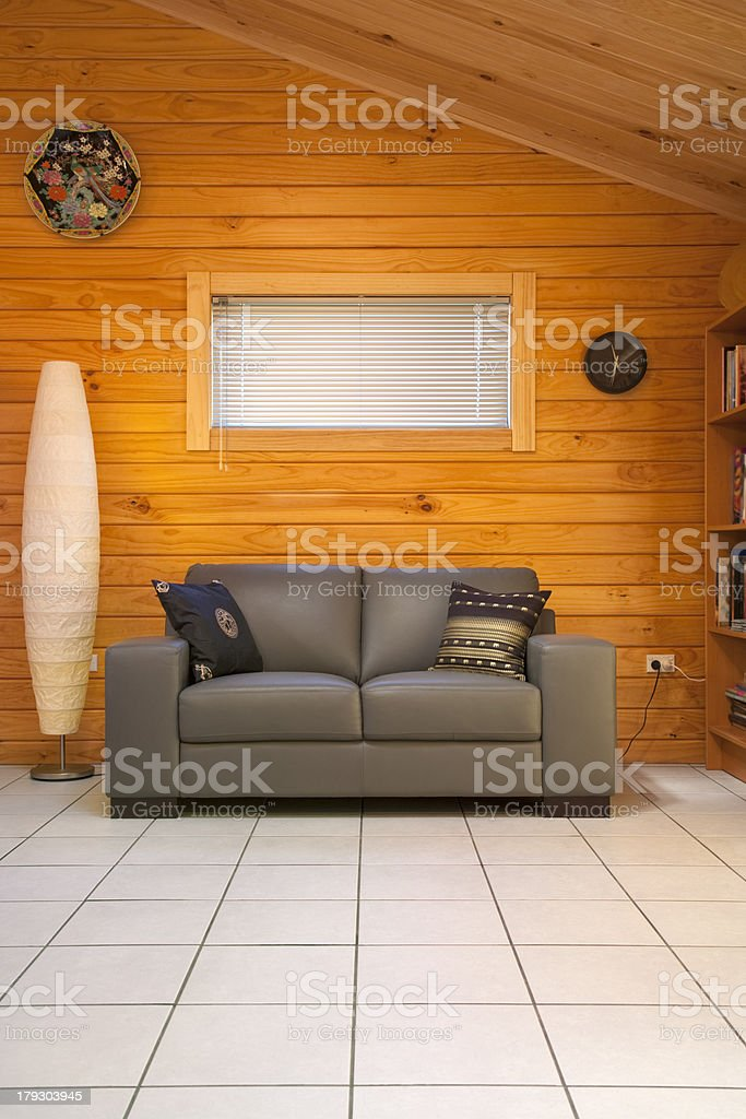 Timber Home Interior Leather Couch Window Venetian Blind Tiled Floor royalty-free stock photo