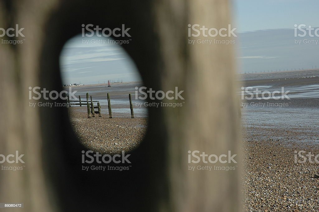 Timber sea defence hole royalty-free stock photo