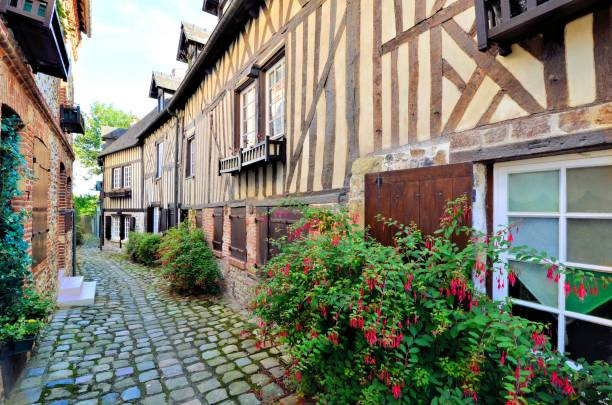 Timbered buildings in the town of Honfleur, Normandy, France Picturesque timbered buildings in the Normandy town of Honfleur, France calvados stock pictures, royalty-free photos & images