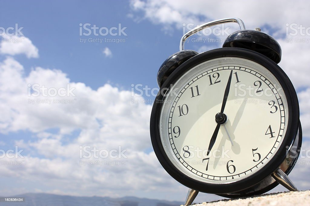 Time and cloudy sky royalty-free stock photo