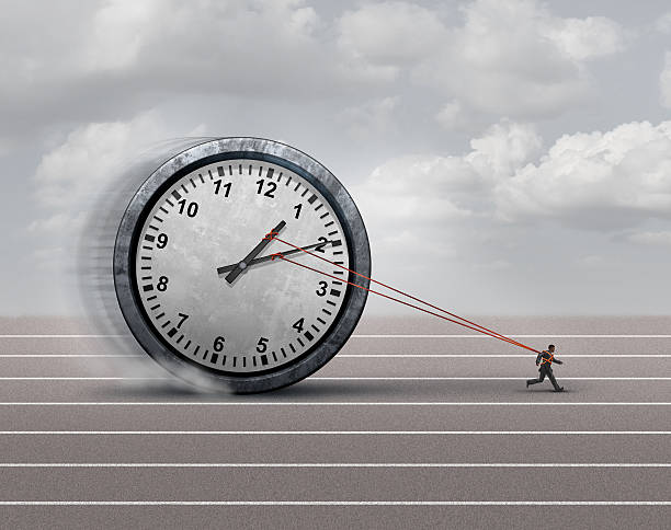 Time Burden Time burden business concept as a burdened businessman or employee pulling a heavy clock as a symbol for deadline stress or schedule pressure and an icon for aging. deadweight stock pictures, royalty-free photos & images