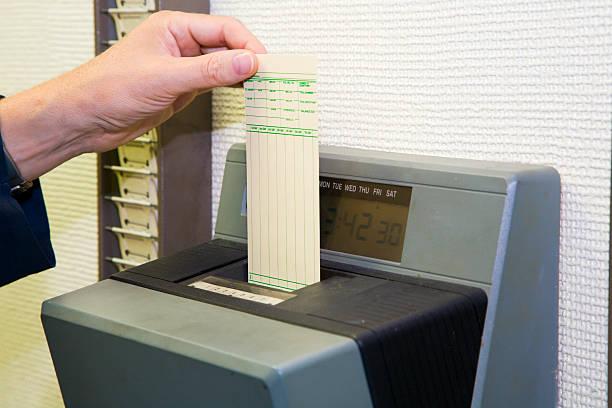 time card - punching stock photos and pictures
