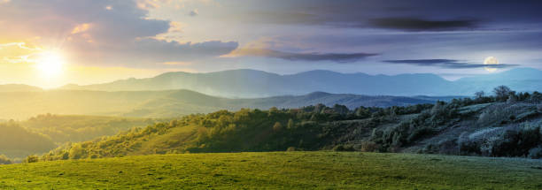 time change above panorama of romania countryside stock photo