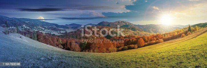 1074120624 istock photo time change above panoramic landscape in october 1164763246