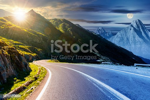 1074120624 istock photo time change above the road in mountains 1074120654