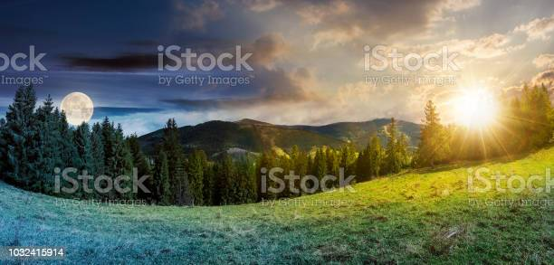 Photo of time change concept above alpine forest glade