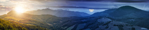 time change concept over the mountainous panorama stock photo