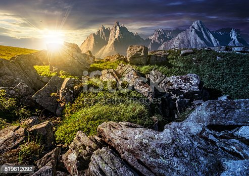 1074120624 istock photo time change concept. rocky peaks and rocks on hillside in High Tatras 819612092