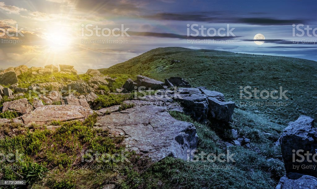 time change concept with huge boulders on the edge of hillside stock photo
