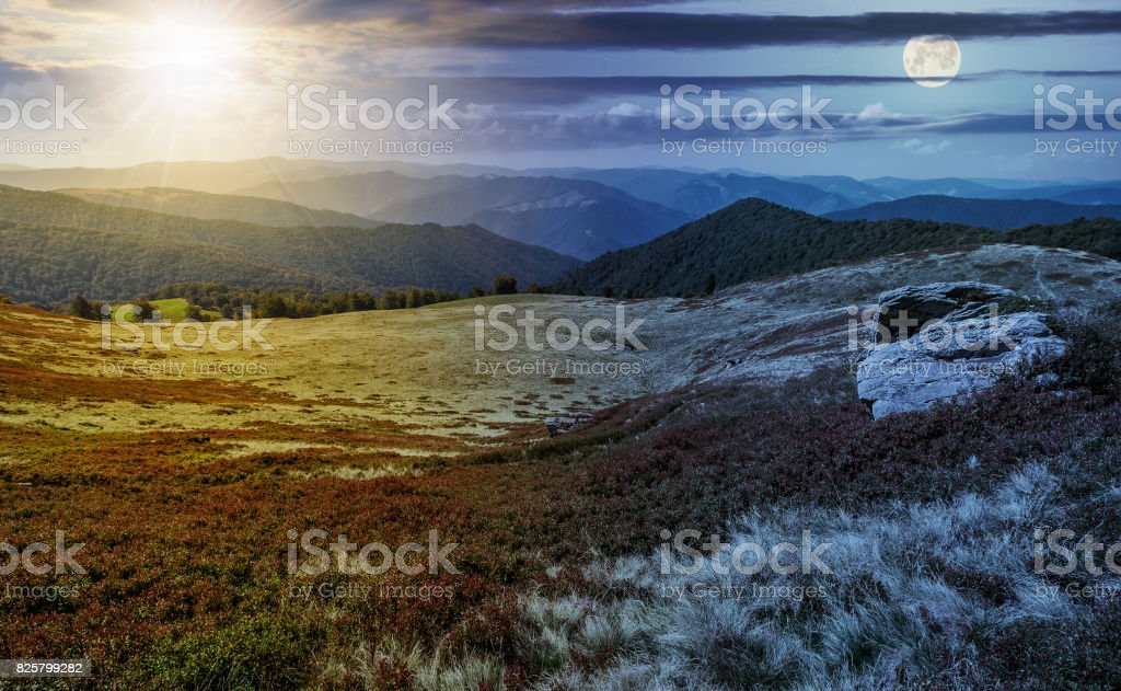 time change over stones on the edge of mountain hillside stock photo