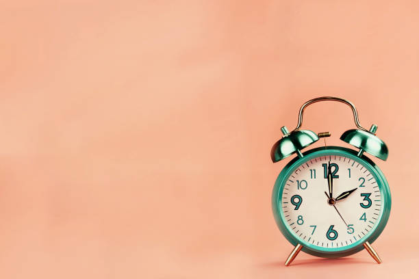 Time change Vintage style alarm clock with room for free background space for text. Perfect for the upcoming time change. daylight savings stock pictures, royalty-free photos & images