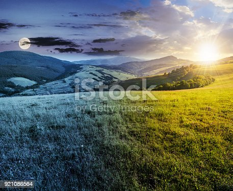 1074120624 istock photo time changes over grassy meadow in mountains 921086564