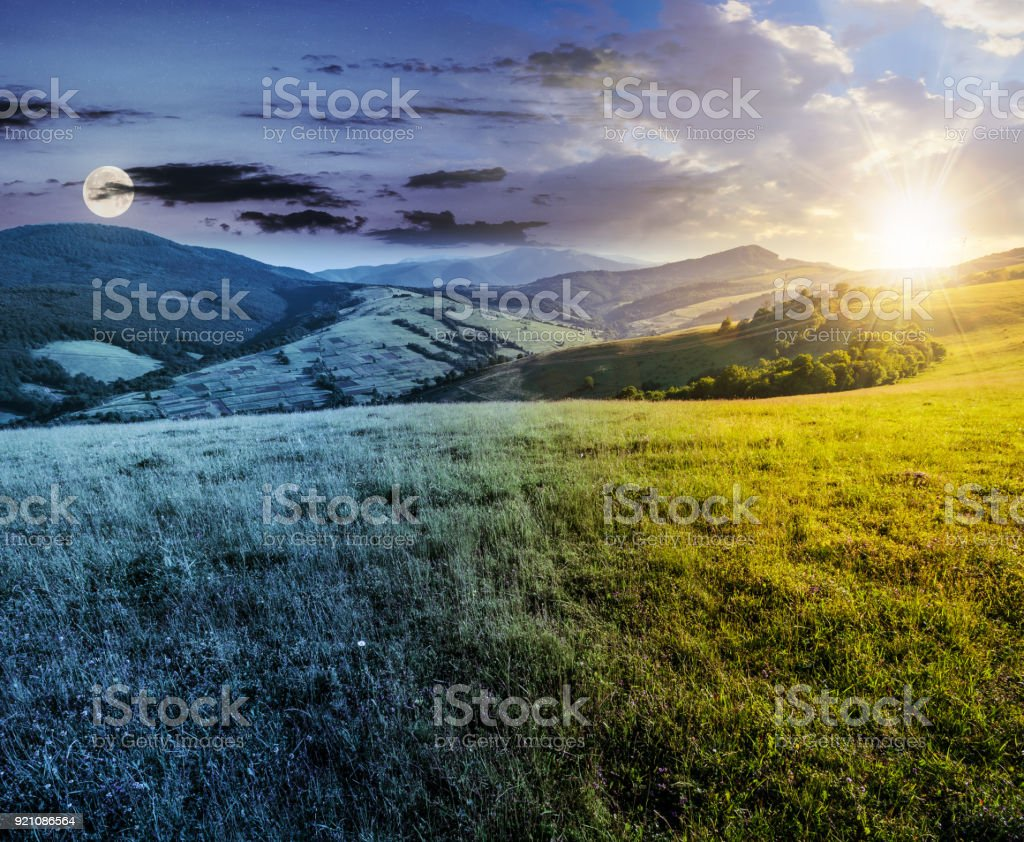 time changes over grassy meadow in mountains stock photo
