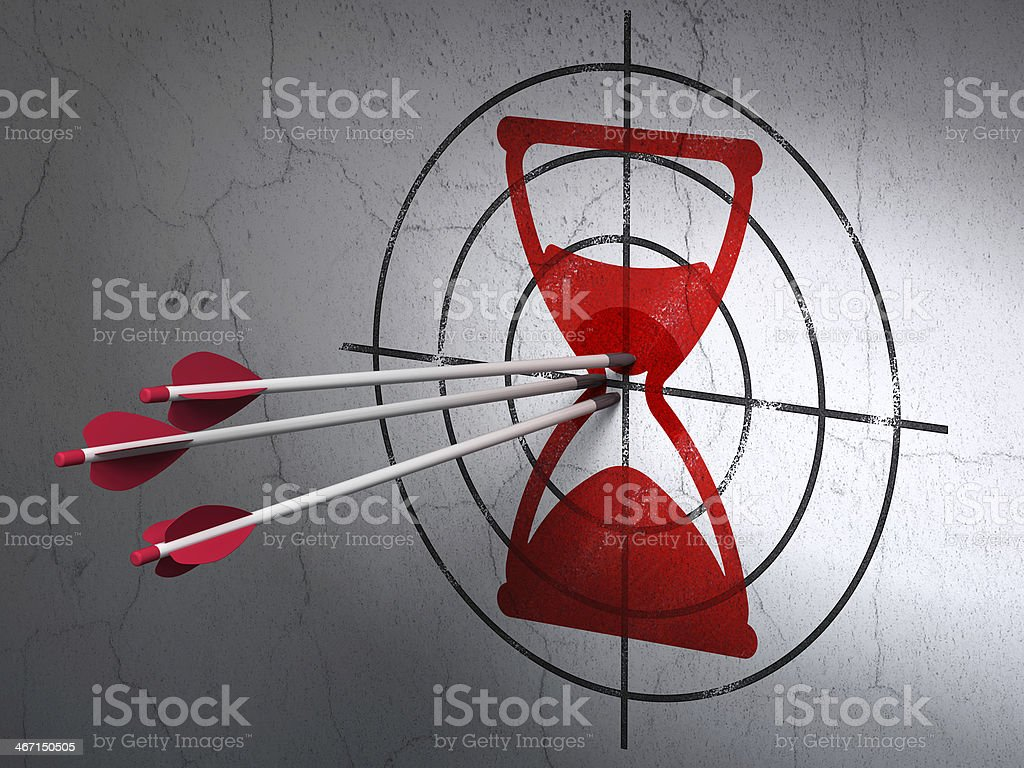 Time concept: arrows in Hourglass target on wall background stock photo