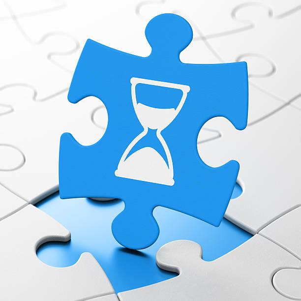 time concept: hourglass on puzzle background - zandloper icoon stockfoto's en -beelden