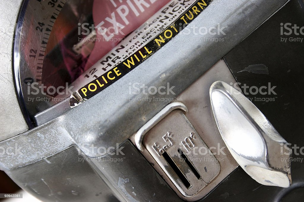 Time expired on parking meter. Close-up. Coin slots. Antique, old. stock photo