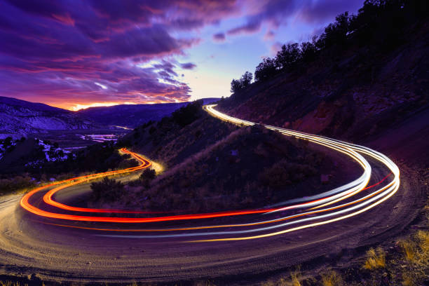 Time Exposure Driving Dirt Road Curve at Twilight stock photo