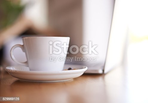 Shot of a cup of coffee on a table in a coffee shop